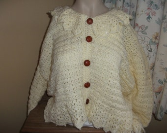 Cardigan with frilly in cream, off white and royal blue crochet