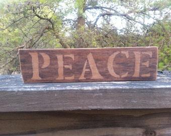 Rustic wood PEACE sign.