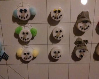 SNOWMAN Magnets.  Decorated with hats and scarves.  Very Cute!