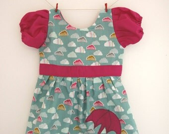 Rainy day princess dress in cloud fabric with pink waistband, sleeves and umbrella on skirt