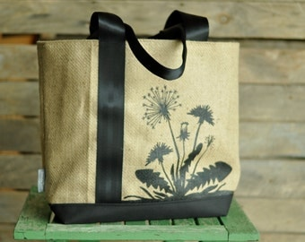 Large, sturdy, canvas, screen print dandelion burlap tote bag.  Seat belt strap.  Market bag, carry on, book bag, multi-purpose