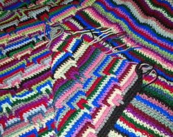 Striped hand crocheted throw blanket with diamonds and fringe
