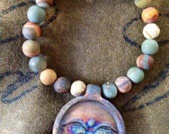 Vintage boho bracelet with Buda eyes pendent