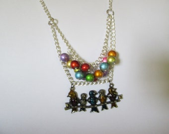 Birds on a branch necklace With Spectra Beads.