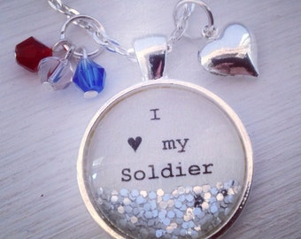 I love my soldier medium glitter pendant with red,white,and blue beads and heart charm