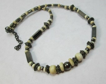 Graduated Bone and Antiqued Brass Tribal Bead Strand 15 inches