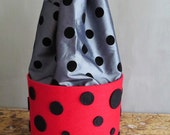 Soft red holder of felt with stuffing and black dots.Home decor .