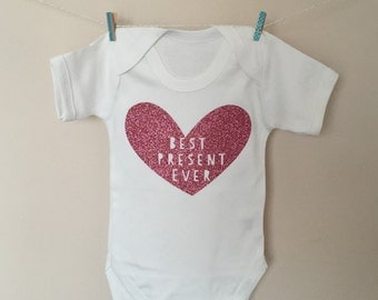 babygrow with best present ever in glitter pink, glitter gold , purple, silver or glitter black