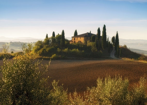 We woke up at 5AM and drove in the dark all around San Quirico d'Orcia, Italy in search of the famous Belvedere farmhouse. Just before daybreak, we found the magical spot allowing us to capture this image: the epitome of picturesque Tuscan countryside.