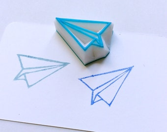 Paper plane stamp. Hand carved stamp. Rubber stamp. Unmounted.