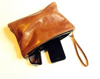 Handmade soft tan leather clutch.