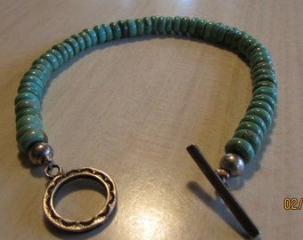 """6mm Turquoise Bead Bracelet with Sterling Silver Toggle Clasp.  7 1/2"""""""