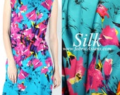 Red Lilies Print Silk. Red floral printed turquoise 19mm silk. Lilies by River. Tropical floral print. Size: 43x55""