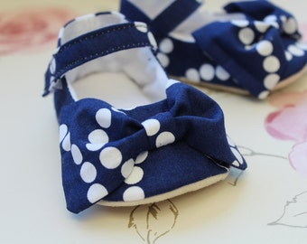 Navy and white Mary Jane baby shoes with an oversized bow
