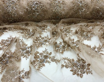 Luxurious Bridal Beaded Wedding lace Gold. Sold by the yard.