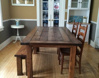 "Handmade farmhouse table with matching bench.  Measurements are  6ft L x 39""W x 31""H. Chairs not included."