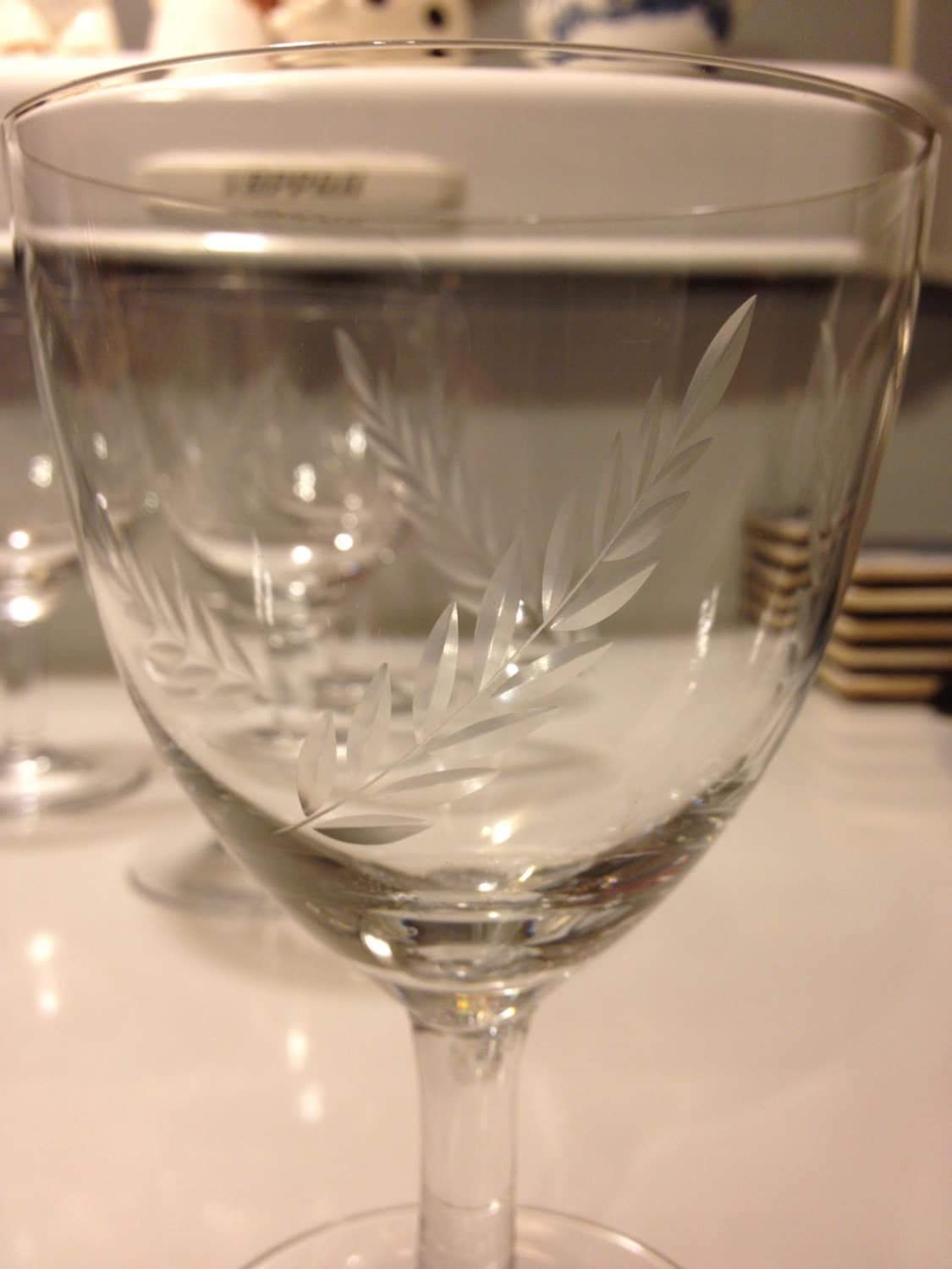 Vintage laurel leaf etched crystal wine stemmed glasses 1950s for Thin stem wine glasses