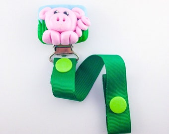 Pacifier holder handmade in polymer clay , pig