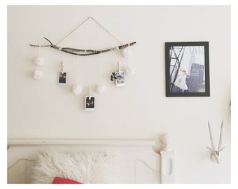 Photograph hanger with pom poms