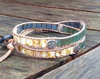 Handwoven Miyuki tila double wrap  bracelet. Earthy colors, natural leather trim, adjustable length.