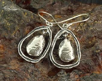 Handmade 925 Sterling Silver free form teardrop shaped dangle earrings. Textured oxidized Silver earrings. Unique artisan design. X763