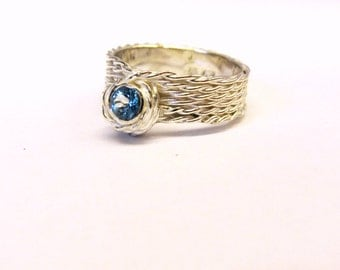 """Silver ring with blue topaz """"Flow"""""""