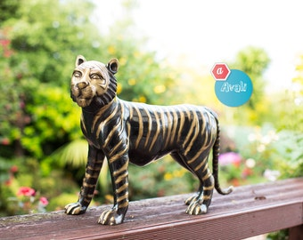 Tiger  Statue with golden stripes. The stripe colour is from the brass, its not painted..