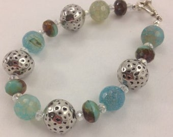 Fire Blue Agate Bracelet with Pewter and blue/brown Cvech Picasso Fired glass beads.