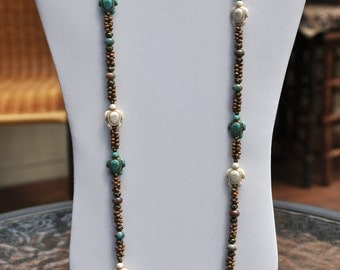 Long turtle necklace in turquoise brown and white