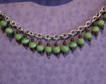Green and brown beaded charm bracelet