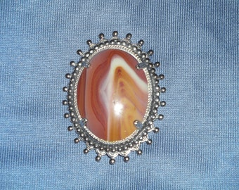 Beautiful hand cut picture agate cabochon set in rhodium plated silver tone setting