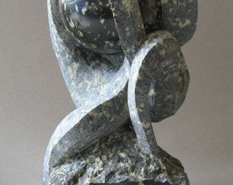 "Green serpentine sculpture. ""Torment"""