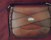 This handmade brown latigo leather handbag made