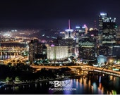 Pittsburgh Cityscape at night with 40' rubber duck in river Panoramic Print