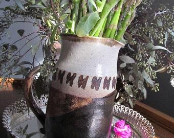 Bohemian earthenware glazed pitcher with primitive markings