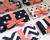 Navy and coral bridesmaid clutches.  Custom colors available.