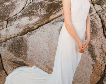 The Petra | by Elika In Love. A modern halter wedding dress, featuring a low back with bias cut skirt. The perfect gown for classic bride.