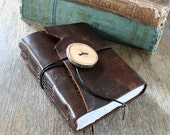 """Leather Journal - Rumi: """"What you seek is seeking you.""""  handmade handbound . medium brown with wooden button (320pgs)"""