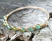 gold bangle, gold bracelet, guitar string bracelet, guitar string bangle, green beaded bangle, beaded bracelet,wire wrapped bracelet