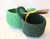 emerald and kelly green nesting bowls with hanging loop made from eco friendly upcycled t shirt yarn by yourmomdesigns