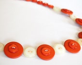 Orange and cream button necklace handmade with upcycled buttons.