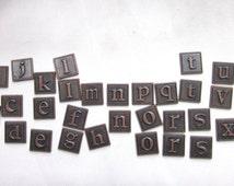 Complete set inidual half inch letter tiles bronze metal 36 total 1