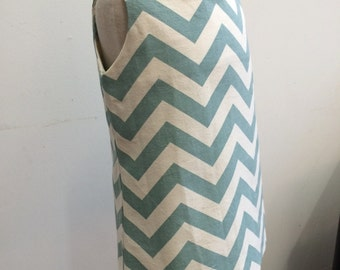 Teal chevron print A line dress with orange piping