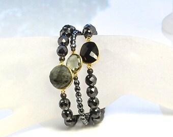 LP 1245  Three Stretchy Hematite Bracelets With Black Onxy and Quartz Bezeled Gemstones