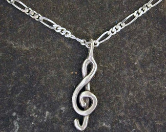 Sterling Silver Treble Clef Pendant on a Sterling Silver Chain.