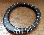 Black resin wangle bangle with nude stripes