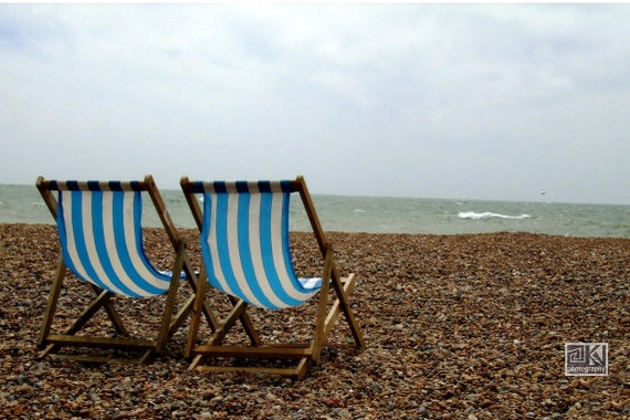Seaside photograph, beach in Brighton, blue and brown, stony beach, beach chairs, stripey chairs