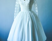 Elegant Ivory chiffon wedding dress, with corset top and wrapped bust design