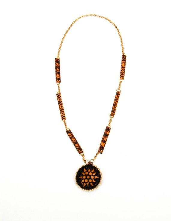 1970s Burnt Wood Medallion Pendant Sun Goddess Necklace