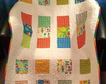 "ABC's, Primary Colors and More, All Together In This 34.5"" X 43.5"" Quilt In The Line Called Apple Jack By Tim and Beck for Moda"